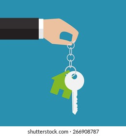 The hand holding a house key. Real estate. Vector illustration. Flat design
