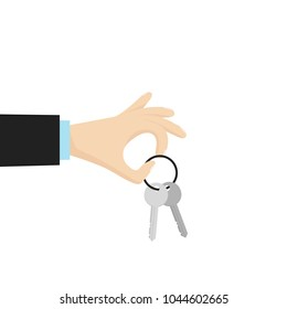 Hand holding house key. Vector illustration in flat style