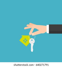 hand holding house key. Vector illustration
