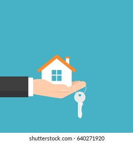 hand holding house and key. Vector image