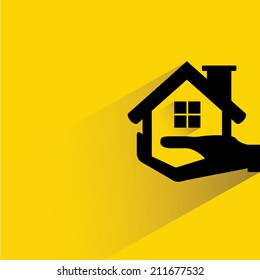 hand holding house, real estate investment concept