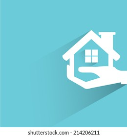 hand holding house, real estate investment concept on blue background