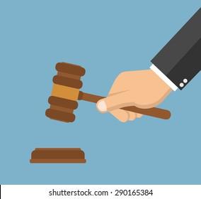Hand holding judges gavel - Flat style