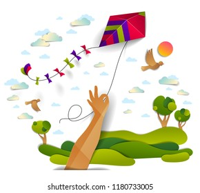 Hand holding kite over cloudy sky birds flying and sun, meadows and trees scenic nature landscape, freedom and easiness emotional concept, vector modern style paper cut 3d illustration.