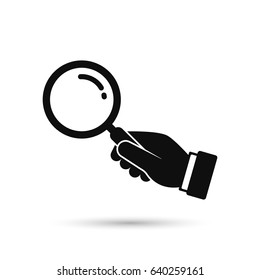 Hand holding magnifying glass icon. Black silhouette isolated on white background. Vector flat illustration. Search concept.