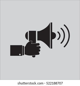 Hand holding a megaphone icon vector