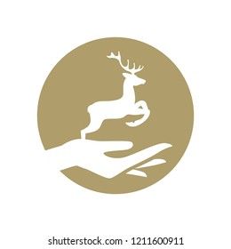 hand holding miniature deer. gold logo icon