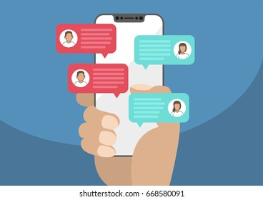 Hand holding modern bezel free / frameless smartphone with chat message notifications. Illustration of chatting speech bubbles as concept of chat, conversation, online dialog.