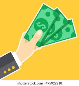 Hand holding money. Dollars, cash, money exchange concepts. Modern flat design vector illustration