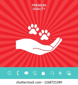 Hand holding paw symbol. Animal protection. Graphic elements for your design