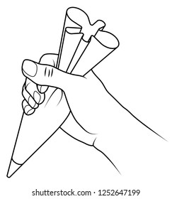 A hand holding a piping bag filled with icing mixture ready to decorate a cake.
