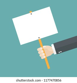 Hand holding a placard with copy space