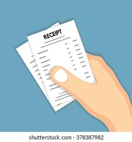 Hand holding receipt .