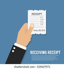 Hand holding receipt