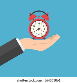 Hand holding red alarm clock showing 8 o'clock on blue background. Time, start, urgency and sleep concept. Flat design. Vector illustration. EPS 8, no transparency