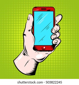 Hand holding red smartphone with blue screen pop art design on green textured background vector illustration