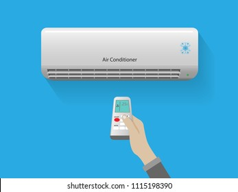 Hand holding remote control open the air conditioner is cooled to 25 degrees Celsius on blue background,Energy saving concept