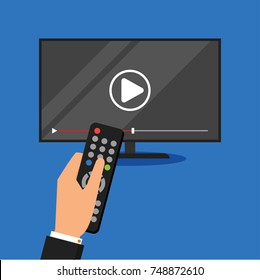 Hand holding remote control. TV icon concept. Illustration in flat style.