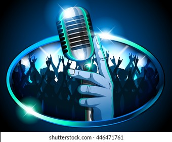 Hand holding Retro Mic/ Microphone in front of huge silhouetted crowd waving arms & cheering signifying a concert, pub, karaoke or talent show.  Blue & Teal color theme with bright lights for effect.