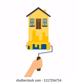 Hand holding roller brush and painting a house. Flat design modern vector illustration concept.