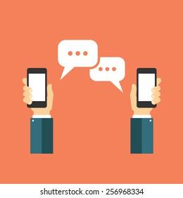 Hand holding smart phone and speech bubbles. Communication concept vector flat design illustration