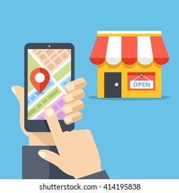Hand holding smartphone with city map and store location on screen and store icon. Mobile navigation, gps navigator, route concepts. Flat design vector illustration isolated on red background