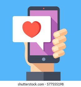 Hand holding smartphone with heart emoji message on screen, like button. Love confession, like. Social network and mobile device. Graphics for websites, web banners. Flat design vector illustration.