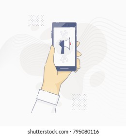 Hand holding smartphone with loudspeaker on screen