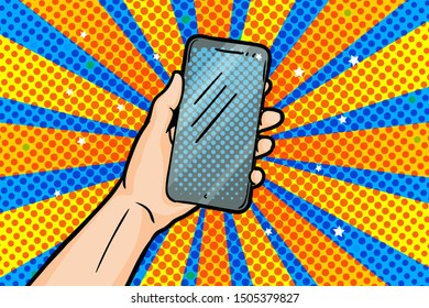 Hand holding smartphone in pop art style on yellow blue background. Vector illustration in vintage comic style.