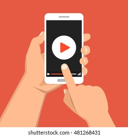 Hand holding smartphone with video player on the screen. Movie app concept. Vector flat illustration.