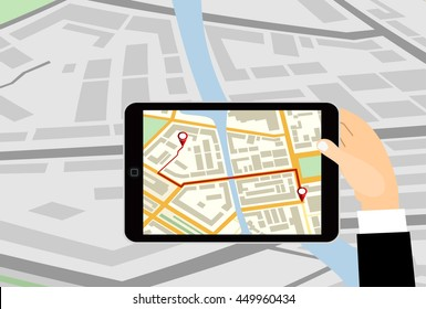Hand holding tablet pc computer with gps navigator map on screen.