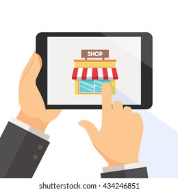 Hand holding tablet and pointing on the online shop web page app on the screen vector illustration