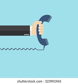 Hand holding telephone. Communication design template. old telephone. flat design. vector illustration