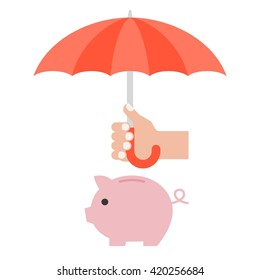 Hand holding umbrella to protect money in piggy bank for financial planing and money management concept