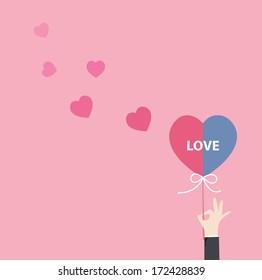Hand holding valentines love heart icon,vector design