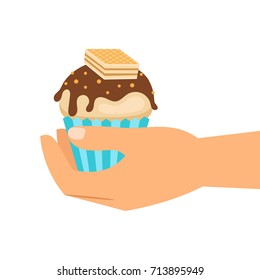 Hand holding wafer cupcake, isolated icon on white background, vector illustration