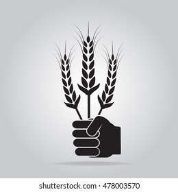 Hand holding with wheat icon