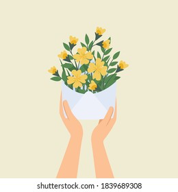 hand holding white letter with yellow flower concept.