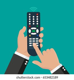 Hand holding wireless remote with finger pushing the button