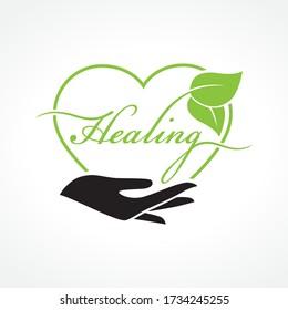 hand holding word healing wirh leaves inside heart