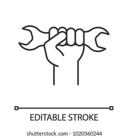 Hand holding wrench linear icon. Thin line illustration. Double open ended spanner. Contour symbol. Vector isolated outline drawing. Editable stroke