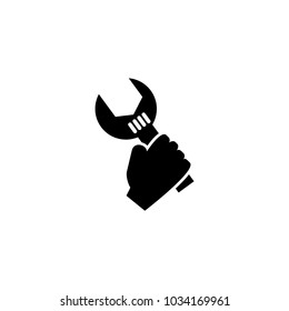 Hand holding up a wrench vector icon