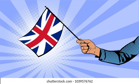 Hand holds the flag of Great Britain.