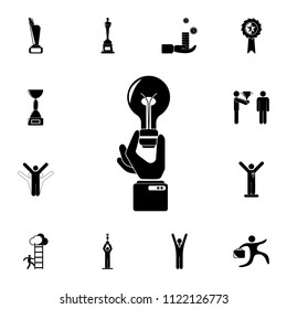 A hand holds a light bulb ideas icon. Detailed set of Sucsess and awards icons. Premium quality graphic design sign. One of the collection icons for websites, web design, mobile on white background