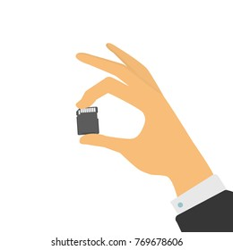 The hand holds a memory card. Vector illustration