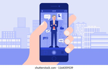 Hand Holds A Smartphone On Which Businessman CEO. Camera Screen Photo. City Buildings On Background.