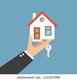 Hand with home and key on finger. Vector illustration flat design.
