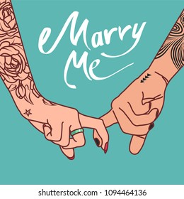 """Hand image with tattoos of a young couple clasped with index fingers with the words """" Marry me"""""""