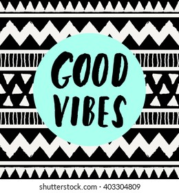 "Hand lettered inspirational quote ""Good Vibes Only"", neon blue colored circle, tribal geometric pattern background. Modern greeting card, poster, t-shirt design."