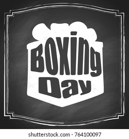 Hand lettering Boxing Day with present box silhouette illustration, isolated on black chalkboard background. Vector holiday design.